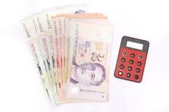 Примечания доллара Сингапура с прибором банка интернета Стоковое Фото