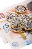 Примечания и монетки английского фунта Стоковое фото RF