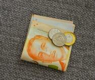 Примечания и монетки доллара Сингапура Стоковые Изображения