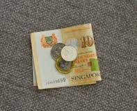Примечания и монетки доллара Сингапура Стоковые Фото