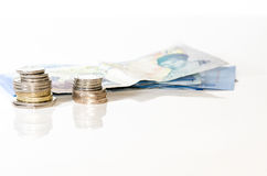 Примечания и монетки стоковая фотография rf