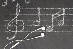 Примечания музыки с наушниками Стоковое фото RF