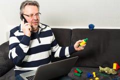 Примирение работы и семейной жизни Стоковое фото RF