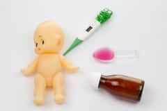 Примите что кукла была больна Стоковые Изображения RF