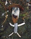 Примитивная скульптура камня утеса бородатого человека Стоковые Изображения