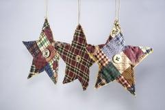 Примитивные орнаменты рождества звезды Стоковые Фото