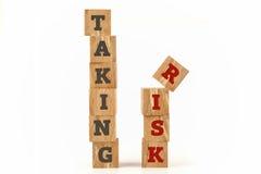 Принимающ слово риска написанное на форме куба Стоковая Фотография