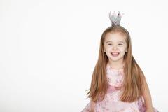 Принцесса маленькой девочки над белой предпосылкой Стоковая Фотография