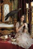 Принцесса рядом с троном стоковое фото rf