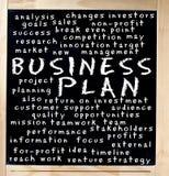 Принципиальная схема бизнеса-плана написанная на доске Стоковое фото RF