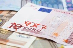 Принципиальная схема взвинчивания с деньгами евро Стоковое фото RF