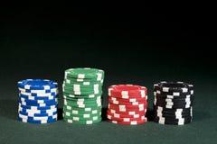 принципиальная схема 4 цвета обломоков играя в азартные игры стоковые фото