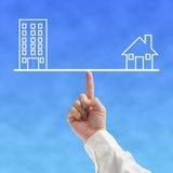 Принципиальная схема баланса дома и офиса с бизнесменом Стоковое фото RF