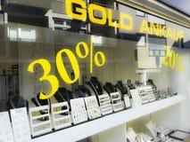Приобретение золота и магазин продажи, приобретение, знаки процентов стоковое фото