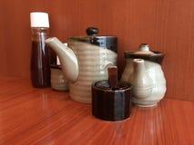 Приправа японского стиля разливает по бутылкам и раздражает предпосылку Стоковая Фотография RF