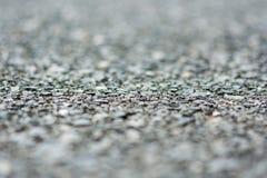 Природа гравия запачканная макросом серая Стоковые Изображения RF