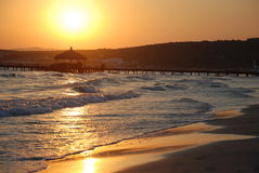 пристаньте восход солнца к берегу Стоковая Фотография