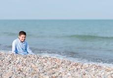 пристаньте детей к берегу Стоковые Изображения