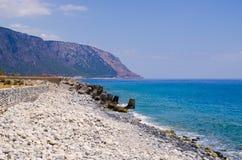 Пристаньте к берегу в конце ущелья Samaria, Крита, Греции Стоковое Фото