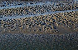 Пристаньте сцену к берегу, приливы вне, влияния текстуры стоковые фото