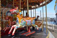 пристань Англии carousel brighton стоковое изображение