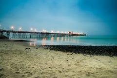 Пристань берега океана хмурая Стоковое фото RF