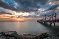Пристань водя в восход солнца Стоковая Фотография