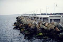 Пристань и камни Стоковая Фотография