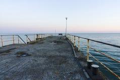 Пристань моря в заходе солнца Стоковые Фото