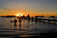 Пристань на заходе солнца в Copacabana, озере Titicaca стоковые фотографии rf