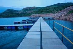 Пристань на озере в сумраке Стоковое Изображение