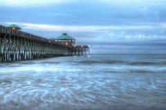 Пристань на пляже сумасбродства Стоковые Изображения
