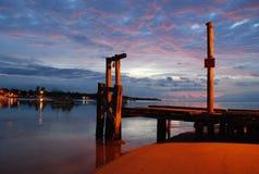 Пристань на рыбацком поселке на зоре стоковое фото