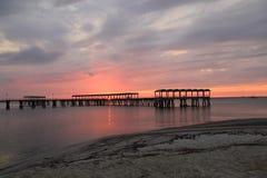 Пристань рыболовства на заходе солнца Стоковые Изображения RF