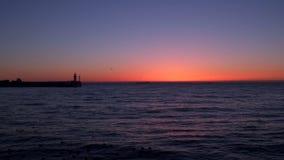 Пристань с маяком против неба на зоре сток-видео