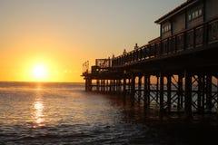 Пристань Teignmouth на восходе солнца стоковые фотографии rf