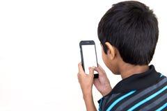 Пристрастившийся к телефону стоковое изображение rf