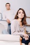 Приятная утомленная женщина сидя дома Стоковая Фотография RF