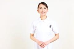 Приятное молодое японское nurse  Стоковое Изображение