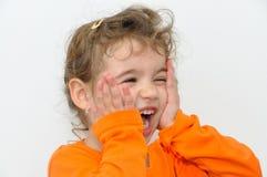 Приятно удивленная маленькая девочка стоковое изображение rf