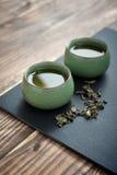 придает форму чашки зеленый чай Стоковые Изображения RF
