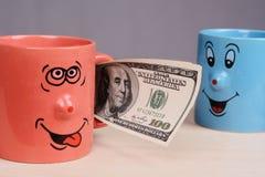 Придайте форму чашки с деньгами долларов в руке Стоковая Фотография RF
