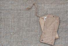 Пробел маркирует ретро стиль на текстуре мешковины Стоковые Фото