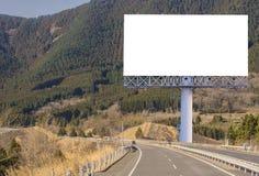 пробел афиши на дороге сельской местности для рекламировать предпосылку Стоковые Фото