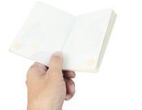 Пробел и рука пасспорта Таиланда на белизне Стоковое Изображение