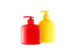 2 пробирки для гигиенических середин. Красный цвет и желтый цвет. Стоковые Фото