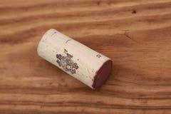 пробочка вина на деревянной предпосылке Стоковое Изображение RF