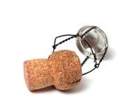 Пробочка и muselet вина Шампани на белой предпосылке Стоковое Изображение
