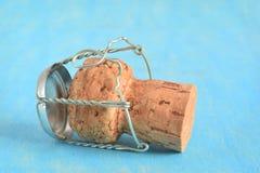 Пробочка Шампани изолированная на сини Стоковое Изображение