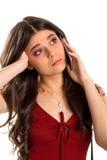 Пробуренная женщина держит сотовый телефон Стоковое Изображение